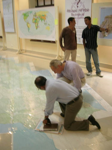 US Ambassador taking a look at the large floor map